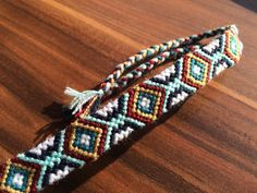 https://www.etsy.com/listing/260616769/friendship-bracelet-woven-wrap-knotted?ref=shop_home_listings
