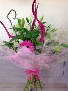 Contemporary hand tied bouquet in shades of pink