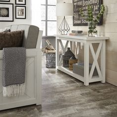 This Home Styles Seaside Lodge Hand Rubbed White Console Table provides a warm inviting cottage feel to your home decor. Seaside Lodge, Seaside Cottage Decor, Seaside Cottages, Home Living Room, Living Room Decor, White Console Table, Console Tables, Sofa Tables, Couch Table