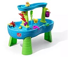 Children will enjoy backyard play time while developing their fine motor and sensory skills with the Rain Showers Splash Pond Water Table. Kids scoop up water from the pond and pour in the top tier to make a showering splash below. Best Water Table, Kids Water Table, Water Play For Kids, Sand And Water Table, Step 2 Water Table, Kids Sand, Water Tables For Toddlers, Backyard Playset, Play Table