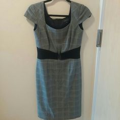 Tahari dress Very professional grey dress. Cute sewn on black belt. Has a small back slit and is very comfortable. Have any questions? Feel free to ask! Tahari Dresses Midi