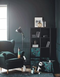 Create smart storage for all ages with furniture and storage from IKEA. Four colourful boxes with lids (TJENA) are easy to reach at the bottom of an open shelving unit. Above there is space to display 'grown-up' knick-knacks.