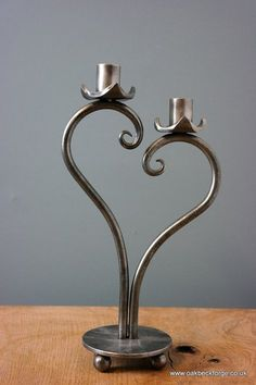 Heart Design Candle Holder The candle holder is forged by hand making each one unique Polished with a Wax finish. Metal Art Projects, Metal Crafts, Welding Projects, Design Candle Holders, Design Candles, Wrought Iron Candle Holders, Blacksmith Projects, Iron Decor, Candle Stand