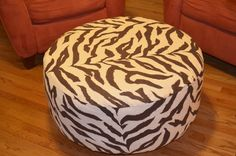 my next DIY project: old tire ottoman, except in yellow chevron (I found this on www.homeattire.net)