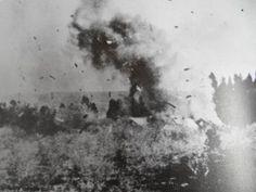 General Louis Botha's farmhouse being blown up by the British. Verskroeide aarde… Genl Louis Botha se huis word opgeblaas deur die Britte.