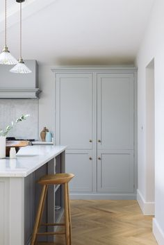 A wonderful big larder cupboard provides lots of storage in this Shaker kitchen cupboards Corner Kitchen Pantry, Pantry Cupboard, Kitchen Pantry Cabinets, Kitchen And Bath, Kitchen Storage, Kitchen Cupboard Colours, Kitchen Larder Cupboard, Kitchen Unit, Kitchens
