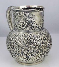 Tiffany repousse sterling pitcher