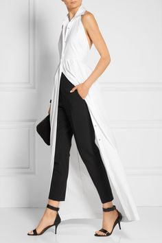 Rosetta Getty Pleated stretch cotton-blend poplin halterneck gown $1,450 White stretch cotton-blend poplin  Partially concealed button fastenings through front 77% cotton, 19% nylon, 4% elastane Dry clean