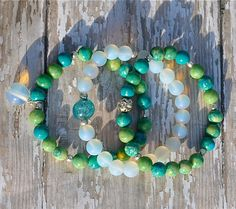 Stack of Spring Green and Opal Beaded Bracelets / by BeadRustic, $55.00 Three handmade beaded bracelets in fresh greens / blues / yellows, with matte Opal with blue glass focal & silver-plated accents . SET OF 3.