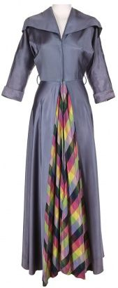 I love this 1940s purple dress! Women's vintage fall winter party fashion