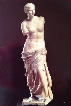 Venus de Milo, Louvre, Paris-Although the Aphrodite of Milos renowned for the mystery of her missing arms evidence proves that the right arm of the statue was lowered across the torso resting on her raised left knee holding the drapery wrapped around her.The left arm was above a herm and held an apple. The right side of the statue is worked more carefully and finished in greater detail than the left side or back.When the left hand was still attached the goddess was looking at the apple.