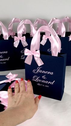 Navy Blue wedding welcome bags with light pink satin ribbon handles and names, Elegant personalized wedding gifts and favors for guests. #welcomebox #personalizedgifts #weddingfavors #weddingwelcomebags #welcomebags #weddingfavorideas #weddingparty #weddingfavorideas #weddingparty #weddingfavour #weddingwelcome #weddingmonogram #elegantwedding #bluewedding #navybluewedding #pinkwedding #blueandpink #treatbags
