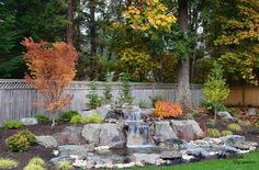 Wonderful Waterfall Design In A Large Fresh Garden Decoration Stunning Waterfall in the Yard - A Shade of Freshness and Tranquility for Elegant Exterior Design garden design, Home design
