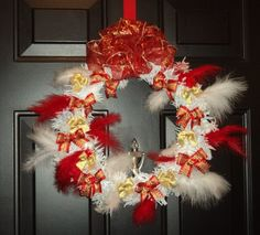 A unique design Christmas Door Wreath (artificial) with Christmas Bows Collections and Feathers.