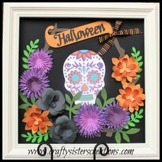 Uses the CTMH Flower Market Cartridge to make a Halloween display in a shadow box.