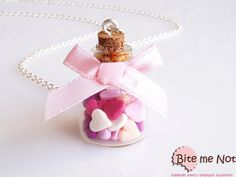 -Silver plated long chain necklace!-Glass bottle, decorated with pink satin bow, full of sugar heart candies in pink shades! So cute!It makes a beautiful set with these items:Ring: