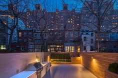Beautiful rear garden idea for some lovely summer evenings Single Family Home In NYC Showcases Townhouse Architecture At Its Trendy Best