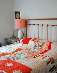 patchwork quilt. iron bed. love.