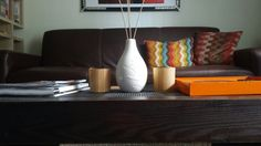 Jensen Merrell's coffee table and couch with nice pops of color.
