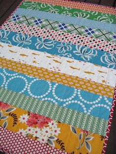 turquoise and orange strippy baby quilt by red pepper quilts