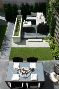 Patio with different areas - sit, eat and greens