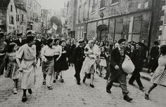 ROBERT CAPA - Woman collaborator is paraded, Chartres