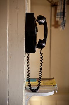 "This is the second kitchen phone that I remember during my childhood and this one had a rotary dial.  The first one sat on the kitchen counter.  We would pick up the receiver and the operator would say, ""Number please.""  Then we would tell her the number we were calling."