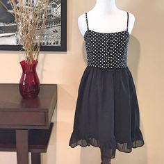 Black & White Polka Dot Top Dress Very cute summer dress. Black and white polka dot top. Straps can be removed for a strapless look as well. Straps are adjustable should you decide to wear them. Hidden side zipper, fully lined, boning in front of bodice of dress for additional support. Faux button detail on front of bodice. Cute ruffle bottom of skirt. 100% rayon exterior, 100% cotton lining. Size small, excellent condition. Worn once. ModCloth Dresses