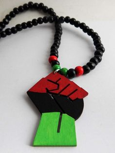 New to TheBlackerTheBerry on Etsy: RBG Power Fist Necklace Red Black Green Wood Beaded Jewelry Fist Pendant Black Power Fist Men Necklace Hand painted African Necklace Hip Hop