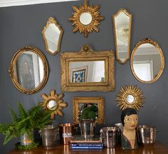 Mirror gallery wall and champagne bucket display featuring finds from European flohmarkts. In-home design provided by Domestic Provisions. Sunburst mirror procured by Emilia's Beautiful Things. Dining Room Mirror Wall, Living Room Mirrors, Wall Of Mirrors, Mirror Bathroom, Mirror Gallery Wall, Vintage Mirrors, Sunburst Mirror, Bedroom Vintage, Plates On Wall