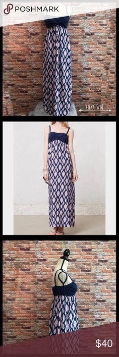 """Anthropologie Lilka Twist Front Maxi Dress Anthropologie Lilka maxi dress in a size medium.  Has adjustable straps and padded bra cups.  Twist front design.  Elastic around the top of the bodice.  Two side pockets.  Long patterned skirt.  Measures approximately 13 1/2"""" armpit to armpit, and 49"""" in length.  55% cotton, 37% polyester, and 8% spandex for the bodice.  Skirt is 100% rayon.  In excellent condition. Anthropologie Dresses Maxi"""