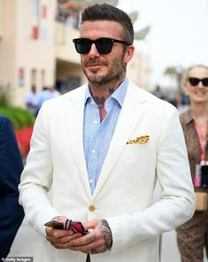 David Beckham Photos - David Beckham walks in the Paddock before the Grand Prix of Bahrain at Bahrain International Circuit on March 2019 in Bahrain, Bahrain. - Grand Prix Of Bahrain Traje David Beckham, Moda David Beckham, David Beckham Suit, David Beckham Photos, David Beckham Style, David Beckham Clothing, David Beckham Fashion, Stylish Men, Men Casual