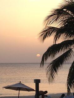 Gorgeous sunset on West Bay Beach , Roatan Honduras.  View from the front of the Beach Club San Simon