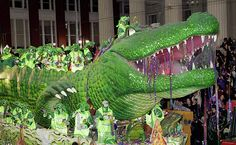 Mardi Gras New Orleans.  Krewe Of Bacchus. Bacchagator float.    The 105-foot, three piece float can accommodate 86 riders.