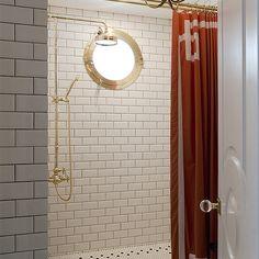 Orange Greek Key Shower Curtain, Contemporary, Bathroom white subway tiles porthole window brass hardware circle moulding door detail lucite door knob