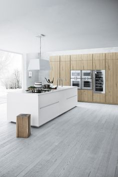 White island and light wood cabinets