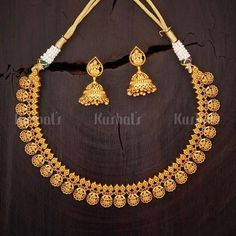 Lakshmi carved coin design necklace studded with synthetic ruby stones plated with gold polish Wedding Jewellery Designs, Antique Jewellery Designs, Gold Earrings Designs, Gold Jewellery Design, Necklace Designs, Antique Necklace, Gold Necklace, Synthetic Ruby, Indian Jewelry Sets