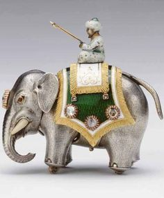 #Fabergé -- Clockwork Elephant -- This piece was presented to King George V in 1929 by his family. It is not known when it was made or for whom. Crafted in gold & silver & embellished with guilloché enamel, rose diamonds, cabochon rubies & ivory, it is wound with a gold key. When placed on an even, flat surface, it walks swinging both its head & trunk. British Royal Collection