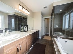 A divine ensuite with dual sinks, a gorgeous shower & soaker tub. Love it! Photo by Digital Video Listings.