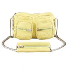 """Alexander Wang Yellow Brenda Chain Shoulder Bag HPAlexander Wang Brenda Chain Shoulder Bag Citrus The soft tumbled lambskin, zippers, and chains lend undeniable attitude. Tumbled lambskin which peels slightly at edges.  Doubled snake-chain shoulder straps with zippered shoulder pad; 22"""" drop. Two-way zip top. Two welt and two zip exterior pockets. 7""""h x 10.5""""w x 3""""d; bag weight: 1lb. Imported of italian material. Color: CITRUS. Small mark on edge of pocket. See additional listing for more…"""