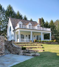 This Colonial Revival style cottage is very well done.The stone work adds to the character and beauty of the property.