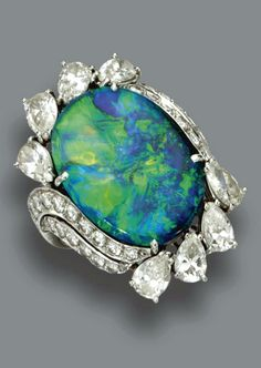 BLACK OPAL AND DIAMOND RING, RUSER, CIRCA 1950 Centering an oval-shaped black opal measuring 19.2 by 14.9 by 5.9 mm., surrounded by a foliate motif set with 8 pear-shaped and 32 round diamonds weighing a total of approximately 3.60 carats, mounted in platinum, size 5½, signed Ruser.