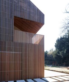 French studio Avenier & Cornejo Architectes has used strips of cedar cladding to wrap every surface of this house in Orsay, France (+ slideshow).