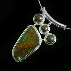 Free-form boulder opal matrix with three bezel set boulder beads. A feature for ladies fashions and jewelry (jewellery)