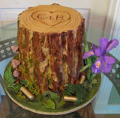 Groom's Stump Cake - The groom is a hunter and both bride and groom enjoy hiking in Oregon where they come across the Oregon wild iris. Chocolate fudge cake with ganache and buttercream frostings. Gum paste decorations.