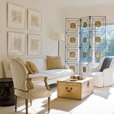 great light. soft lighting. i like the screen and also that trunk as coffee table.