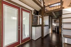 French doors and hardwood floors - Nooga Blue Sky by Tiny House Chattanooga