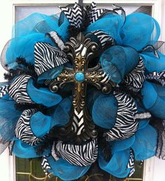 Zebra and turquoise mesh wreath $95.00 from Etsy.com  https://www.etsy.com/listing/129178311/zebra-turquoise-mesh-wreath-animal-print
