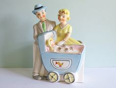 1957 Nursery Planter, Proud Parents Pushing a Baby in a Carriage. $33.90, via Etsy.