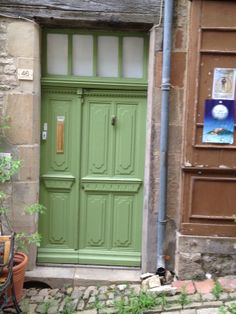 love the rustic colour of this green door in France